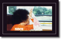 Sri-Sathya-Sai-Baba-looking-out-of-a-bus-window - wallpaper large size 1600x 1200
