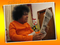 sri-sathya-sai-baba-high-resolution-picture-reading-newspaper