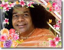 Sri-Sathya-Sai-Baba-smiling-flowers-frame-photo-wallpaper