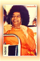 bhagawan-sri-sathya-baba-holding-his-sun-glasses-smiling-on-a-bus-photo