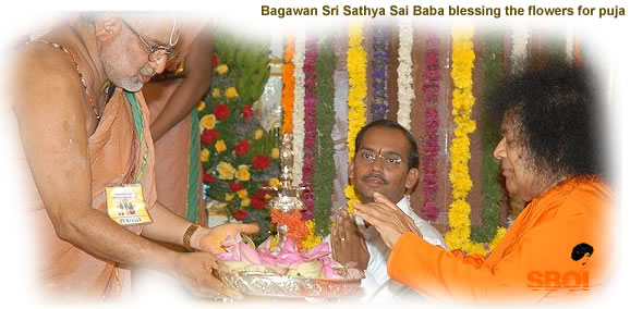 June2008 - sai_baba_blessing_the flowers_for_puja